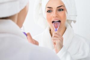 Surrey dentist recommends a tongue scraper